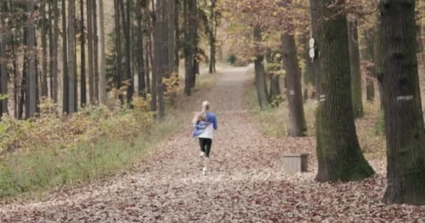 Fitness, Sport People and Healthy Lifestyle Concept - Back View of young Girl Running In Autumn Park
