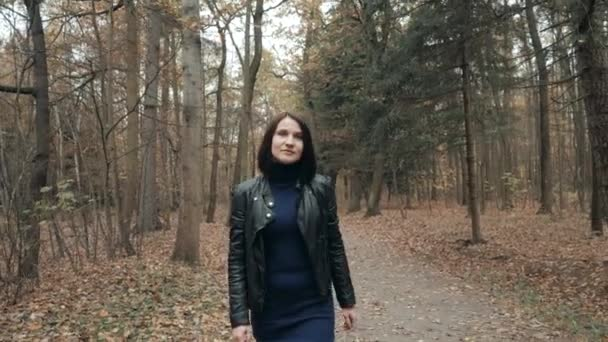 Young Beautiful Woman Walking In Autumn Park. Girl Walking In Forest In Fall, Lifestyle Concept