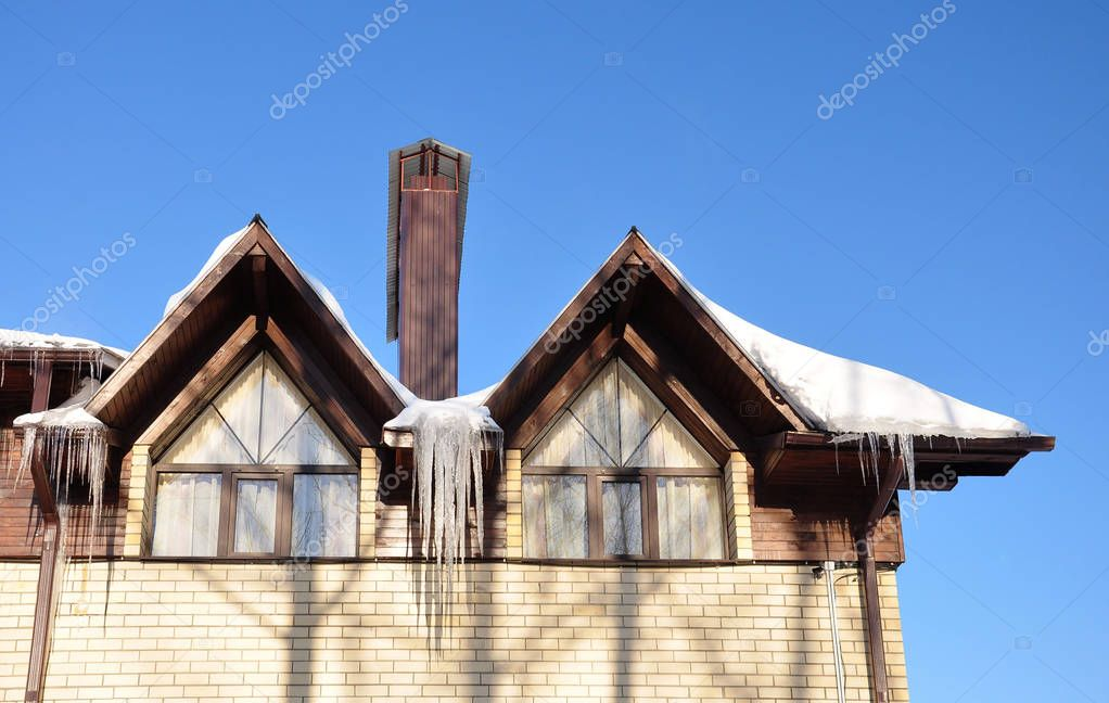 Icicles on the roof of the cottage.
