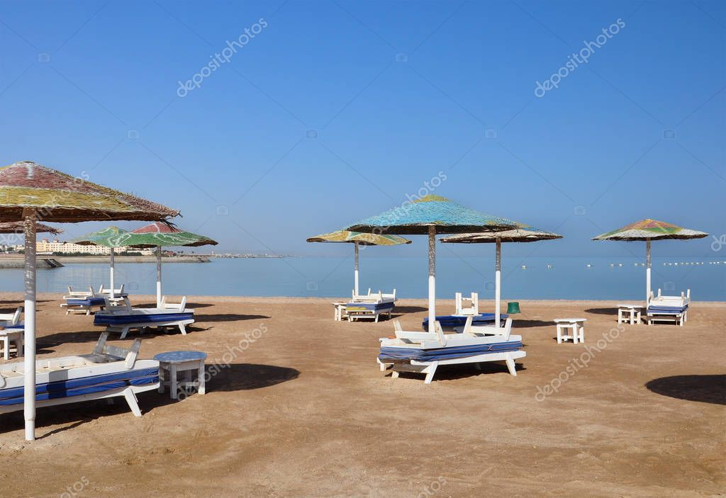 Parasols and sun loungers on the beach in Egypt.