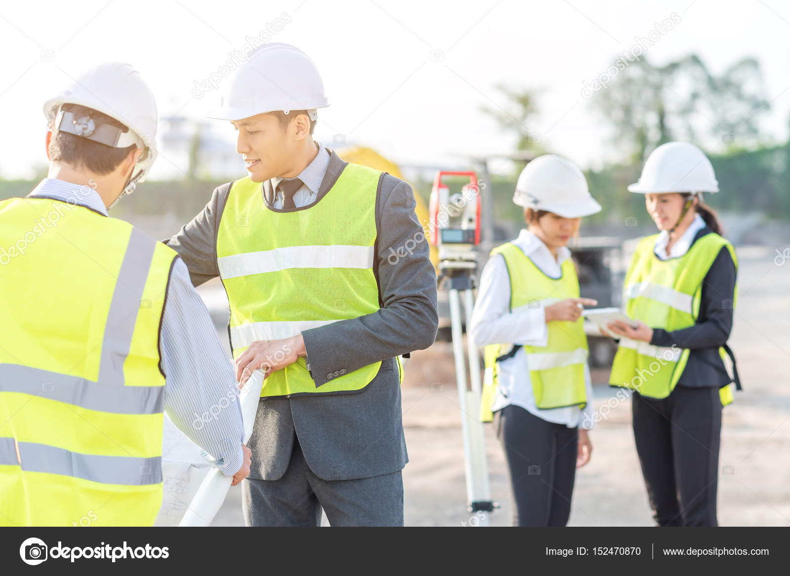 Engineer and builder review blueprint at construction site stock engineer and builder review blueprint at construction site stock photo malvernweather Image collections