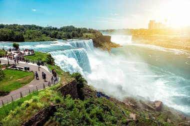 American side of Niagara falls, NY, USA. Tourists enjoying beautiful view to Niagara Falls during hot sunny summer day