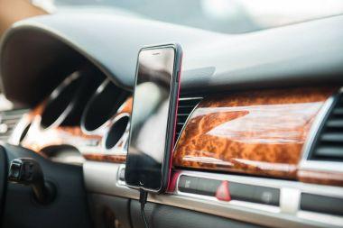 Mobile phone on magnet car mount phone holder for GPS.