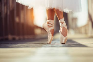 beautiful legs of female classic ballet dancer in point