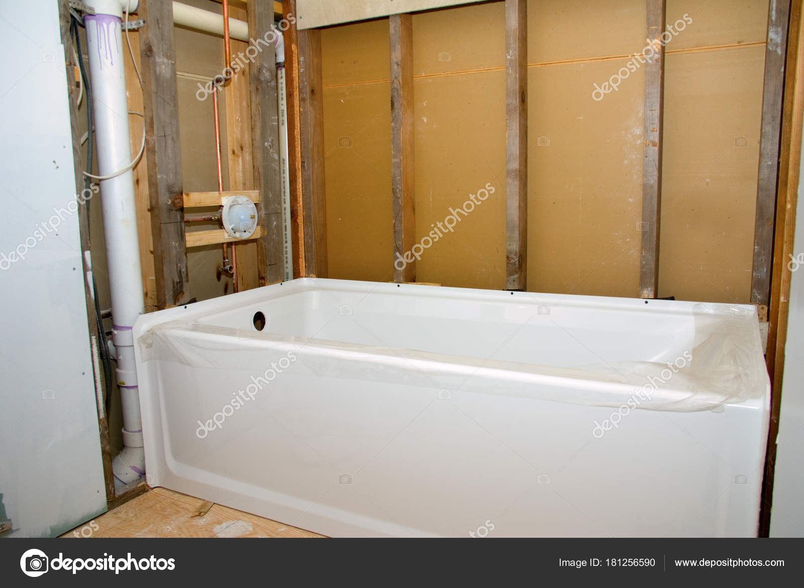 https://st3.depositphotos.com/1066221/18125/i/1600/depositphotos_181256590-stock-photo-bathroom-remodel-tub-and-bare.jpg