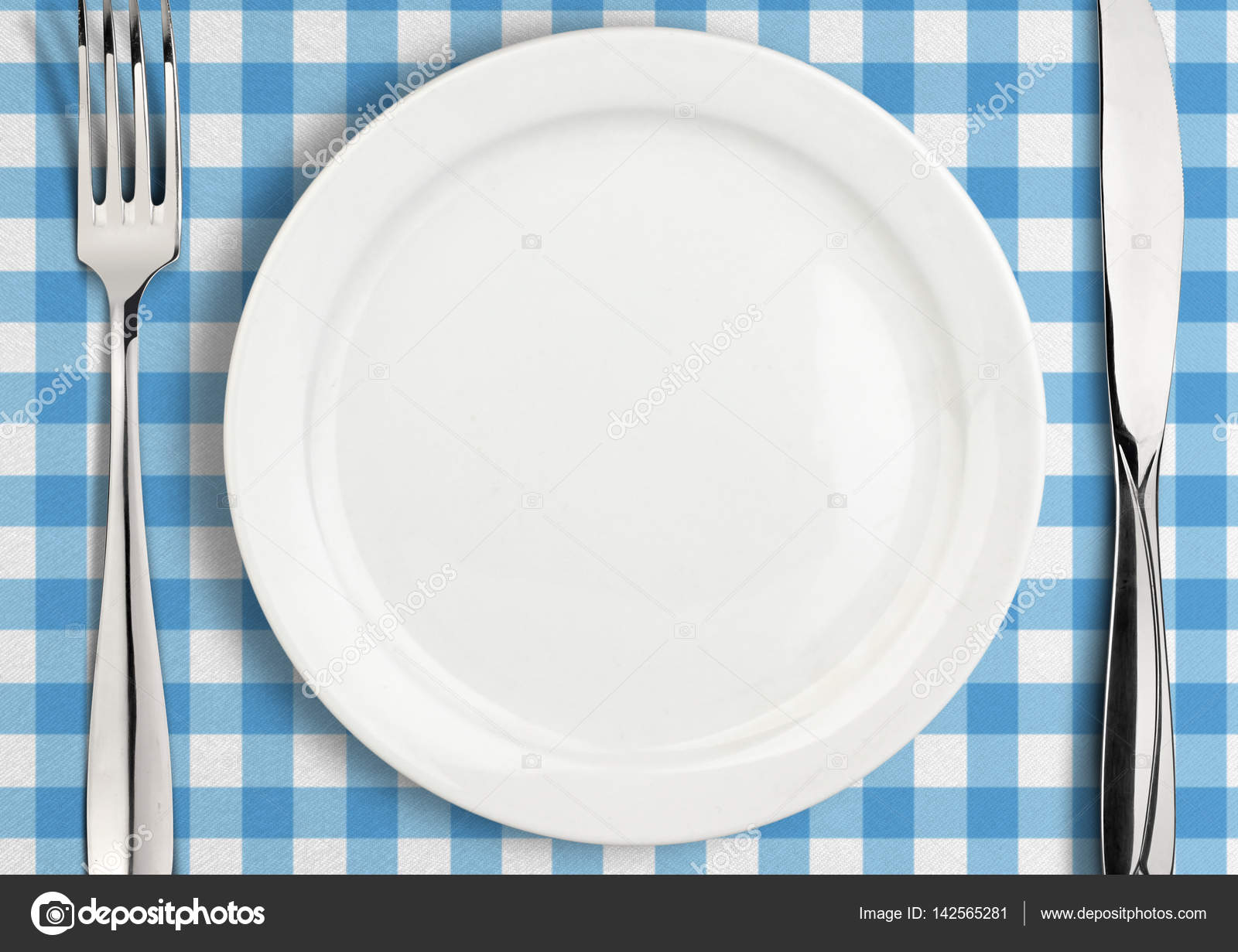 Table setting, empty plate and silverware on towel, top view — Stock ...