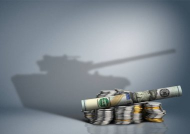 military budget concept, money with weapon shadow