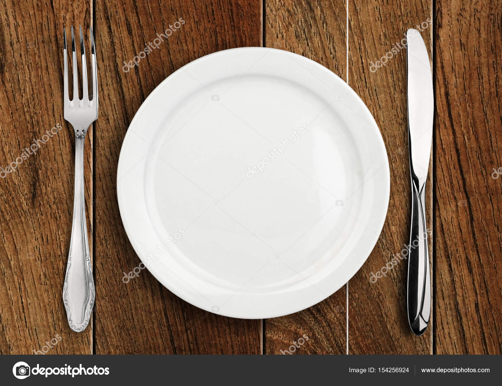 Table setting empty plate and silverware on wooden table top v u2014 Stock Photo & Table setting empty plate and silverware on wooden table top v ...