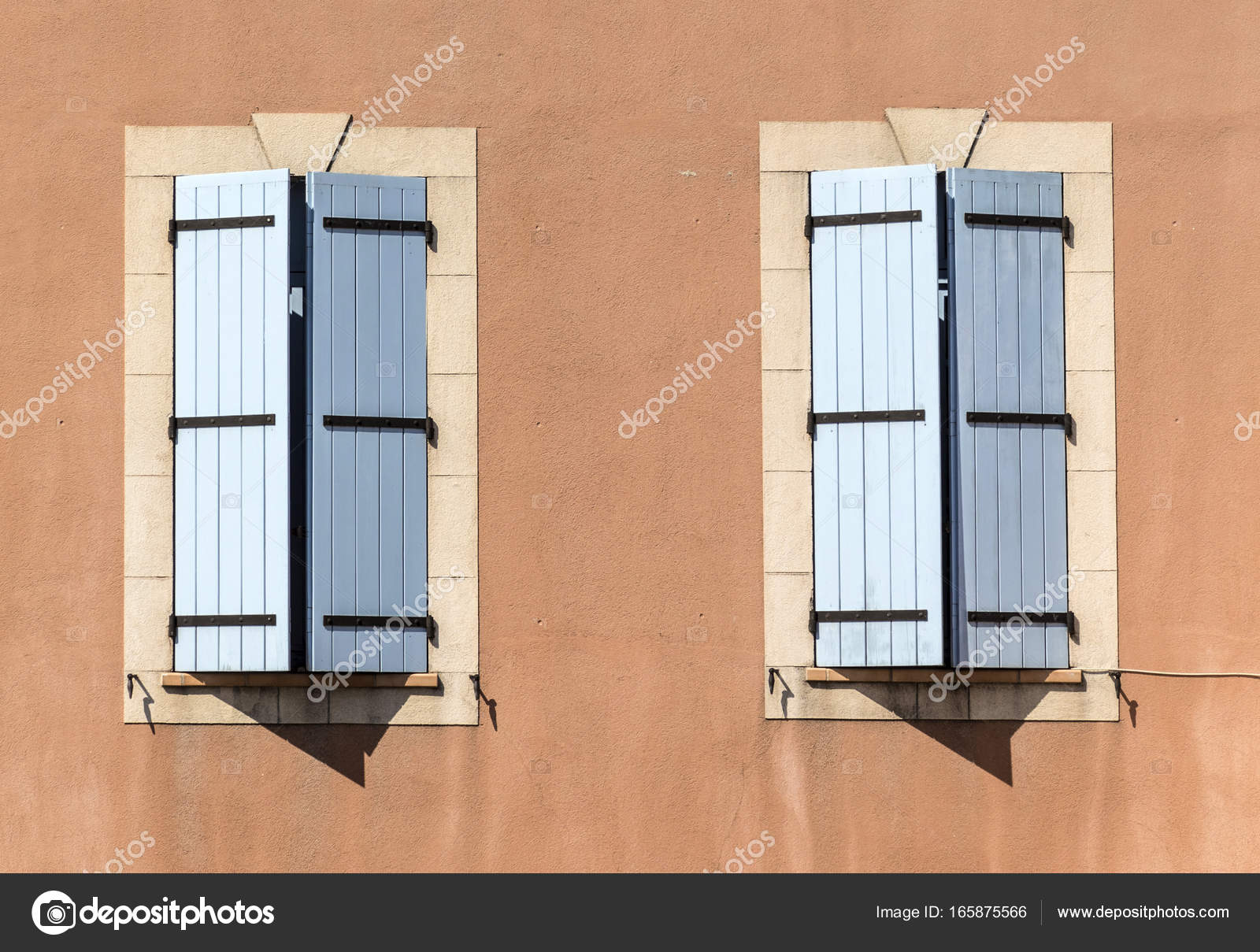 Traditional French Window With Wooden Shutters At An Old