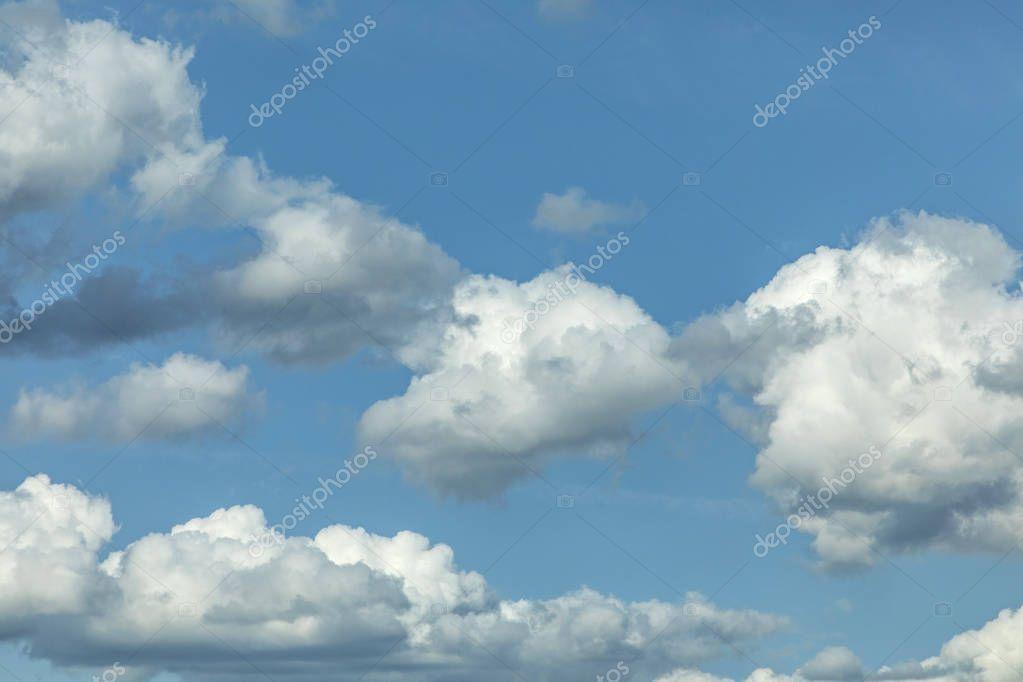 blue puffy clouds