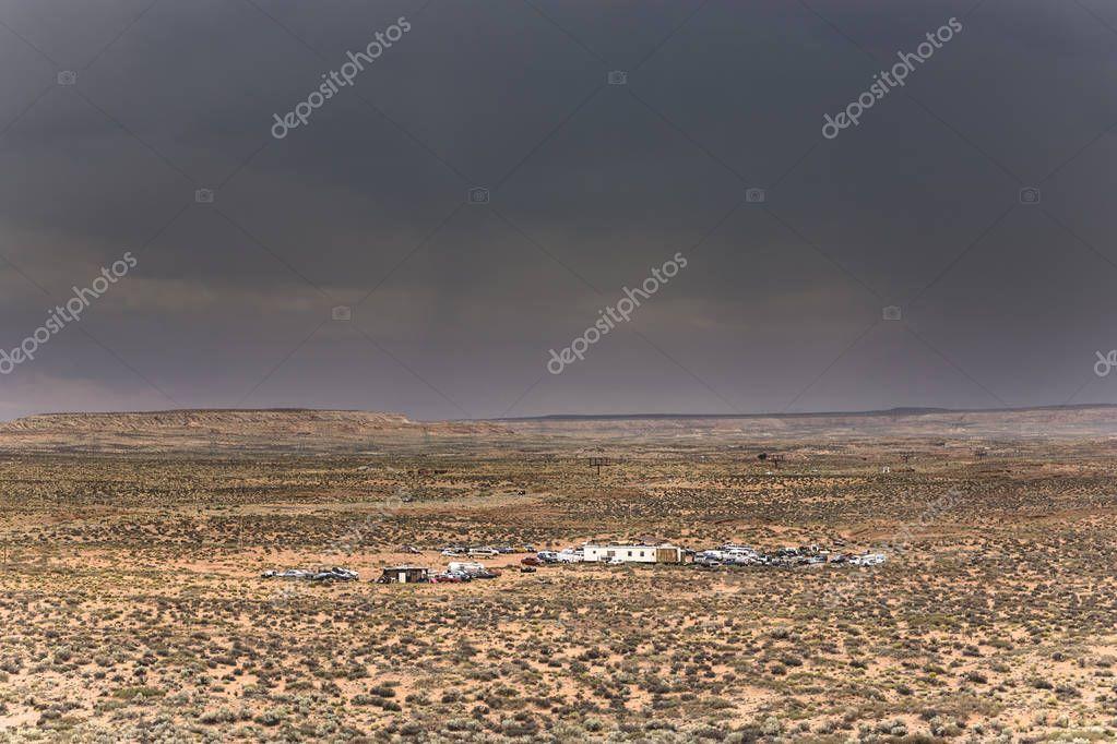 mobile homes in landscape under bad weather