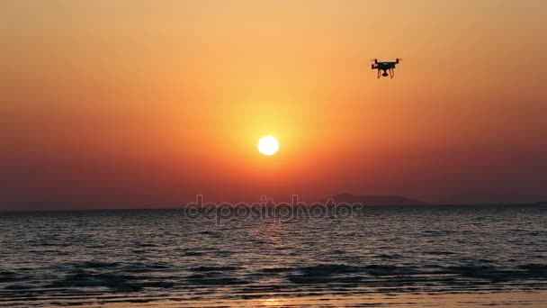 Remote controlled drone with flying in the sunset sky