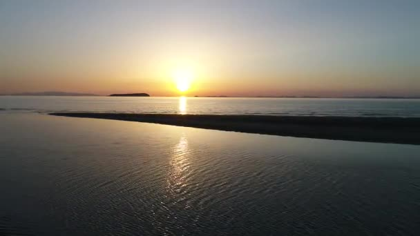 aerial drone flying, aerial view, dolly in of calm, evening sea