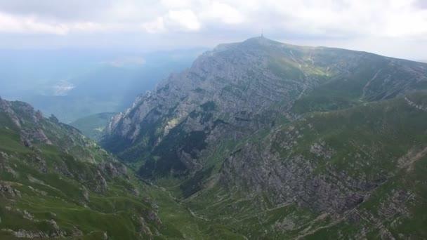 Aerial flight from Omu peak to Caraiman, Bucegi mountains, Romania