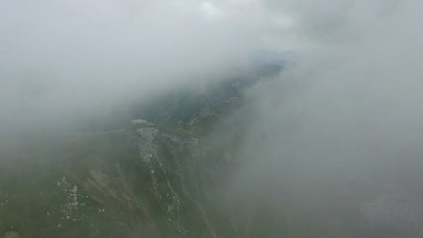 Aerial view of Bucegi mountains reveiling from the clouds, Romania