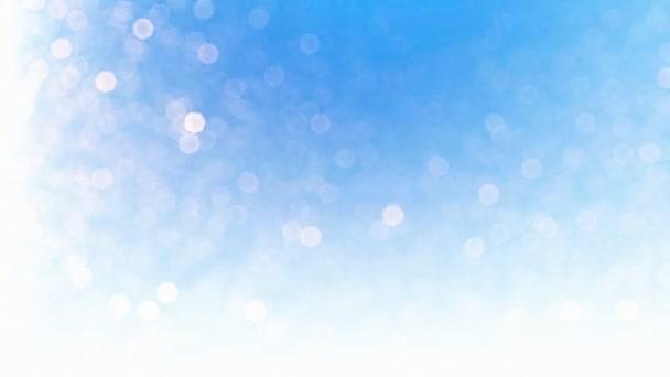 Krásný sníh částice bokeh, proti modré