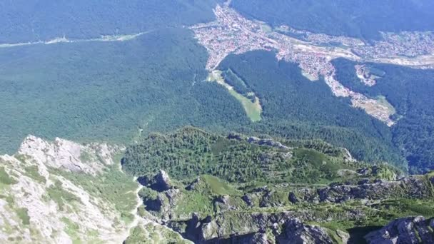 Caraiman Peak, aerial tilt to Bucegi city, Romania