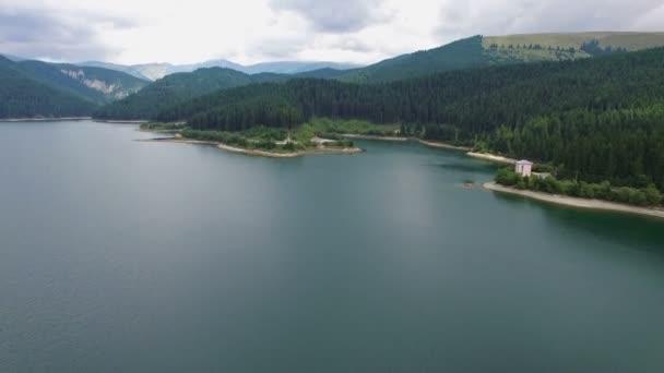 Aerial view of Bolboci lake and Bucegi mountains, Romania