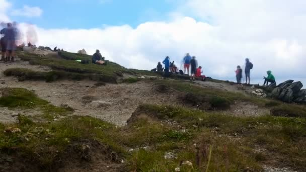 Mountaineers resting, timelapse clouds
