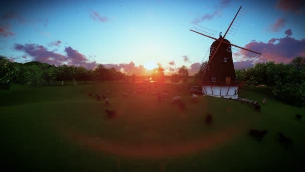 Ovce a větrný mlýn na zelené louce, západ slunce