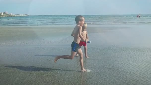 Little boy running on a beach, flares, slow motion
