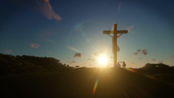 Christians praying at Jesus cross at sunrise, 4K