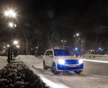 Russia, Togliatti - DECEMBER 25, 2016: Snow test drive of Mercedes GL and GLS with tuning kit Black Crystal of LARTE Design Tuning Company.