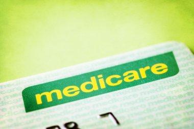 Australian Medicare card over textured background. stock vector