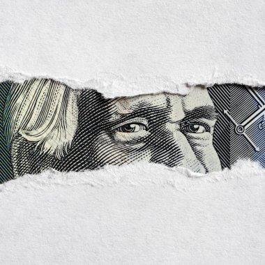 Australian Money Face through Torn Paper