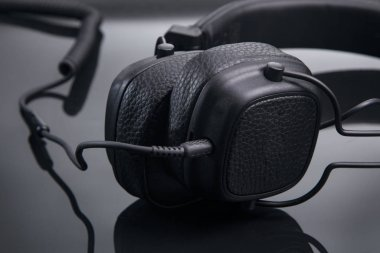 black headphones on a glossy table close-up