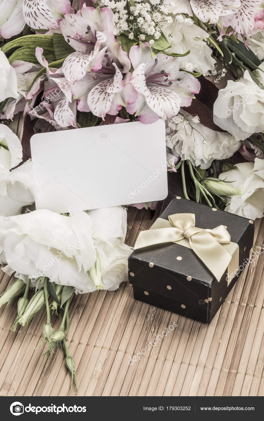 gift and flowers with name tag stock photo bernanamoglu 179303252