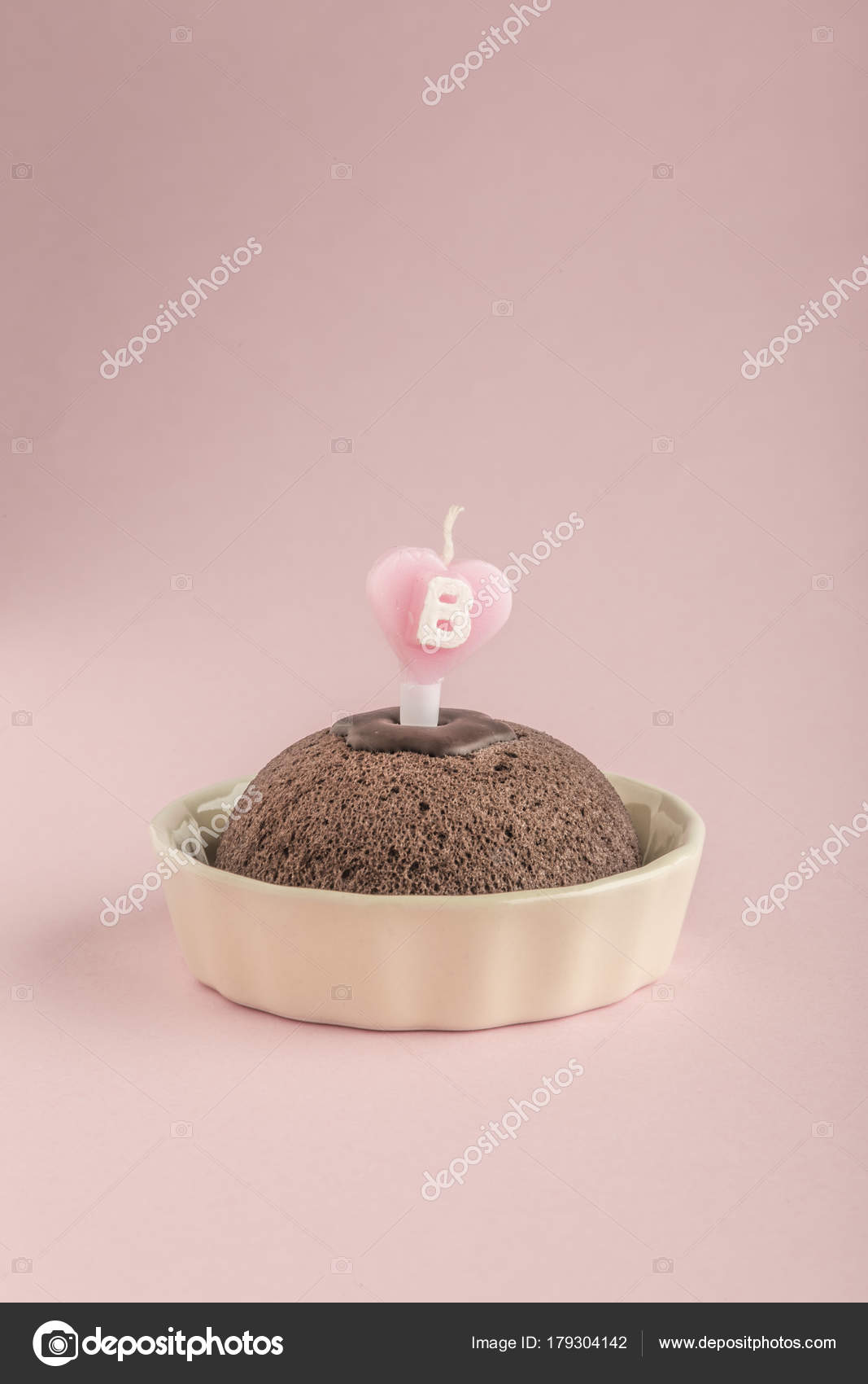 Birthday Cake With Heart Shaped Candle On Pink Stock Photo