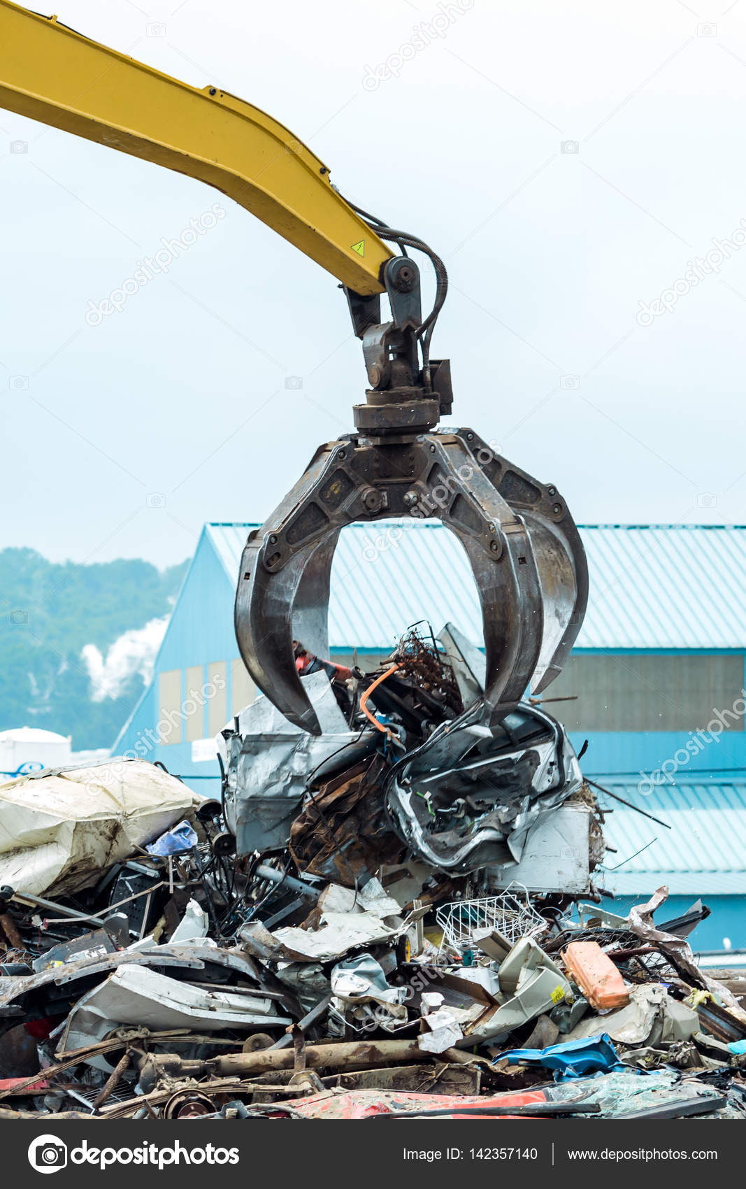 Metal Scrap Yard Crane — Stock Photo © mary981 #142357140