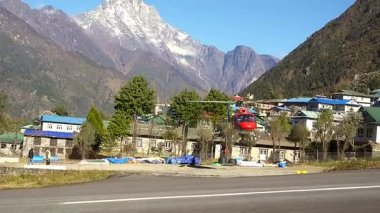 Lukla, NEPAL - October 26, 2017: Helicopter in the sky