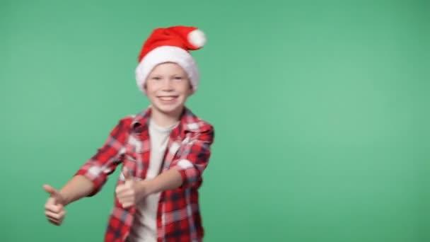 Cute little boy in a santas cap fooling