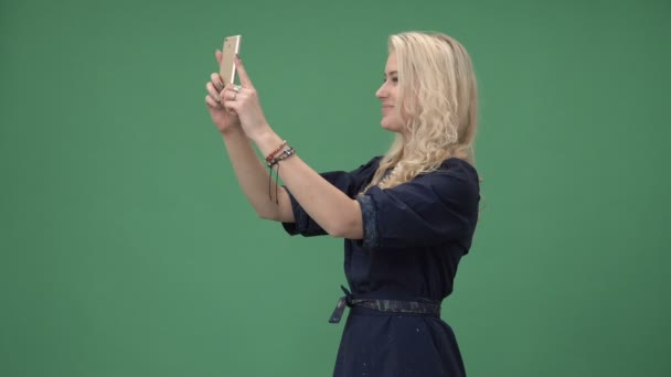 Young blonde woman making selfie