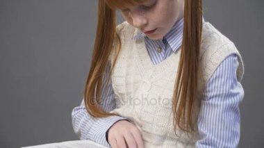 Close up little girls hand holding a book