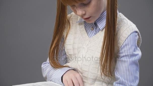 Close up little girls hand holding a book