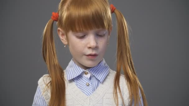 close up cute ginger girl with pigtails is reading the book — stock