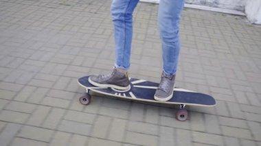 Legs riding the longboard