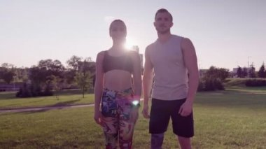 Fitness man and woman in a city park