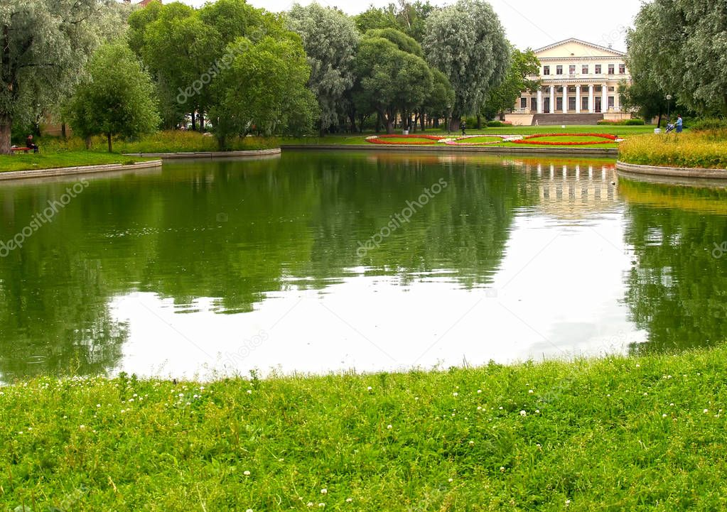View of a pond and the former Yusupov Palace in the Yusupov garden. St. Petersburg