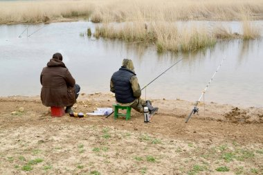 Two men on fishing at the river Manych. Kalmykia