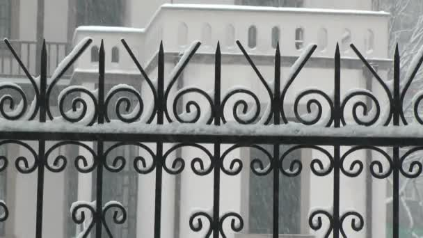 wrought iron and snowfall background