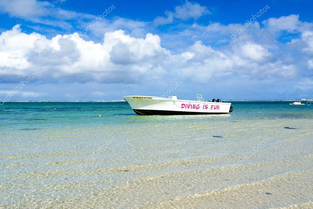 Powerboat in the crystal water of ocean