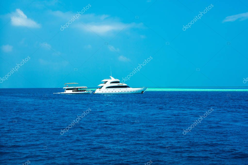 Yacht in the crystal water of ocean