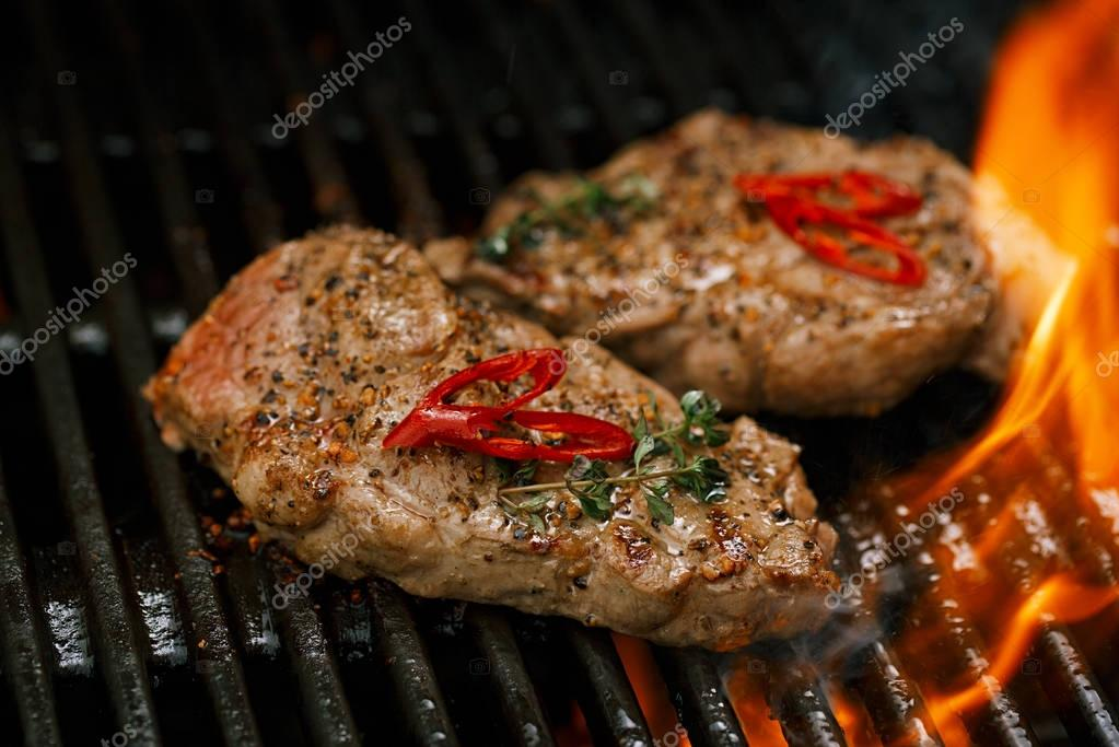 beef steaks on barbecue grill
