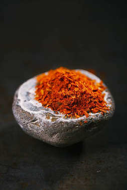 aromatic ras el hanout in stone mortar, traditional spicy mix from Morocco
