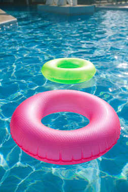floating rings on blue water swimpool