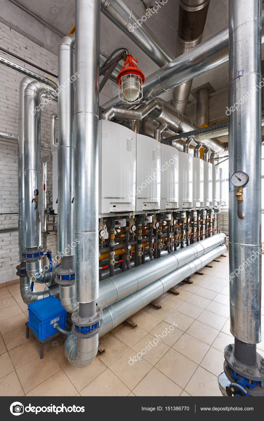 Interior of industrial, gas boiler house with a lot of boilers a ...